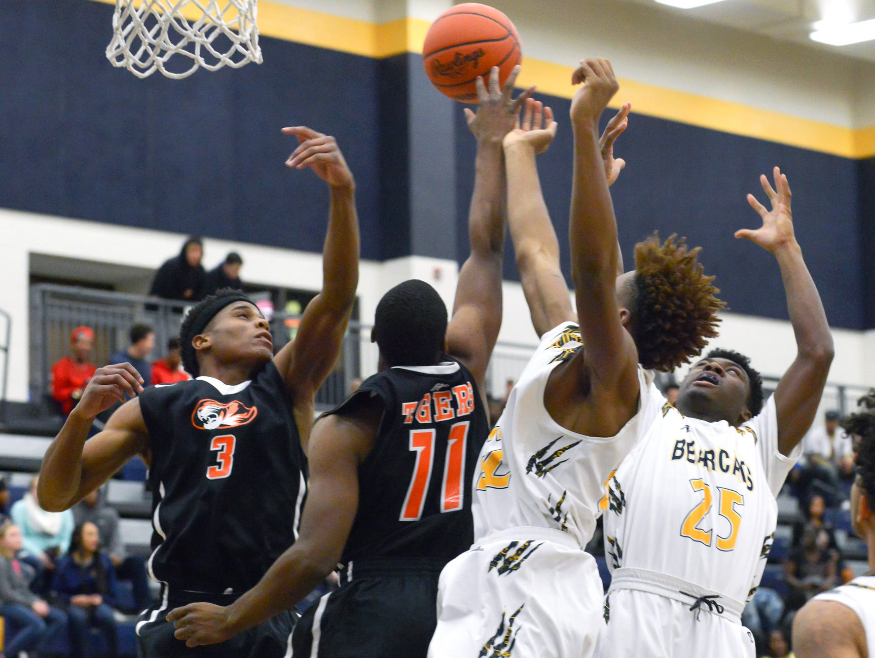BC Central and Benton Harbor Tigers battle for a rebound early in the first period Tuesday night.