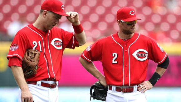 The Reds' Todd Frazier, left, and Zack Cozart on May