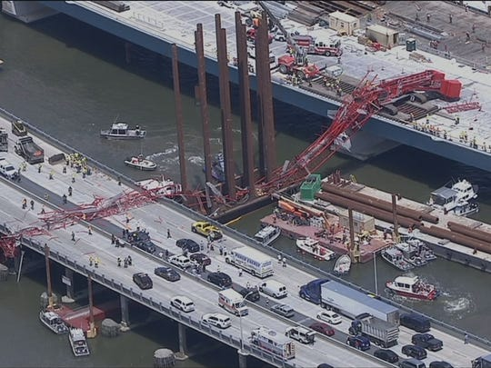 Aerial photo's of a construction crane that has collapsed onto the Tappan Zee Bridge.