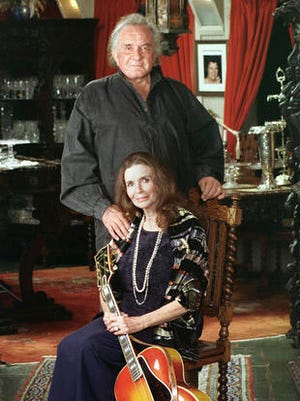 FILE - In this 1999 file photo, late country music legends Johnny Cash and June Carter Cash at their home in Hendersonville, Tenn. The famous Tennessee lakeside property where Johnny and June Carter Cash spent much of their 35-year marriage has been listed for sale.