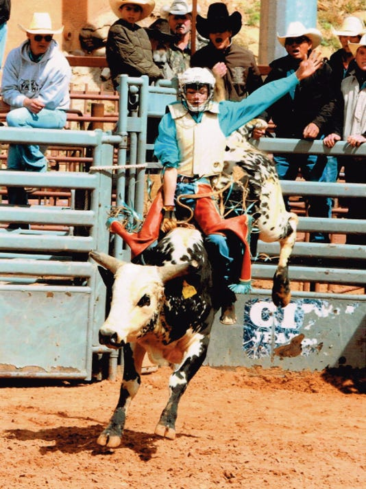 Tadd Dictson takes the state junior high bull riding championship.