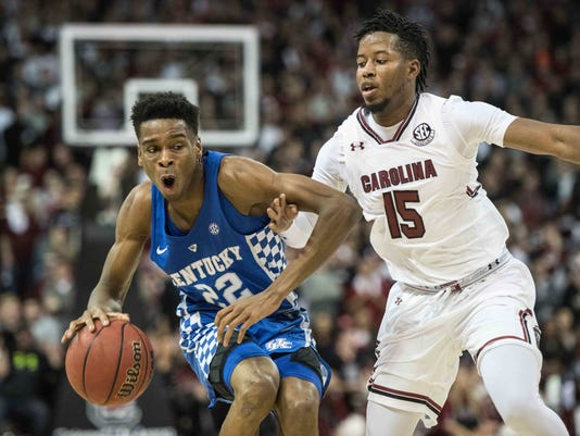 Kentucky guard Shai Gilgeous-Alexander (22) dribbles the ball against South Carolina guard Wesley Myers (15) during the first half of an NCAA college basketball game Tuesday, Jan. 16, 2018, in Columbia, S.C. (AP Photo/Sean Rayford)