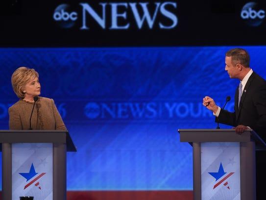 Hillary Clinton and Martin O'Malley participate in