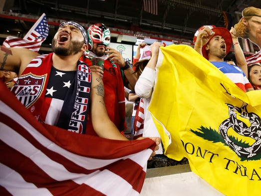 Soccer fans cheer before a friendly match between the U.S. and Mexico at University of Phoenix Stadium April 2, 2014.