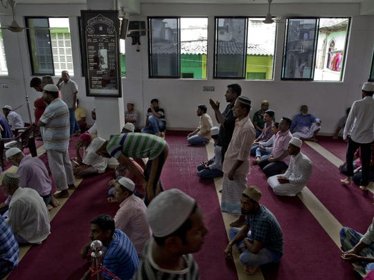 Muslim men gather to pray at a mosque in Colombo, Sri Lanka, Friday, April 26, 2019.