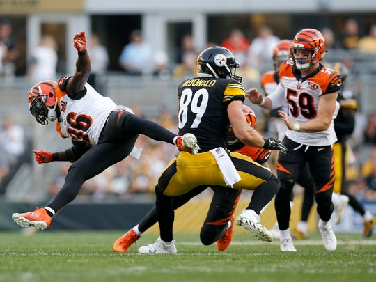 Cincinnati Bengals strong safety Shawn Williams (36) bounces off of Pittsburgh Steelers tight end Vance McDonald (89) after missing a tackle in the first quarter of the NFL Week 7 game between the Pittsburgh Steelers and the Cincinnati Bengals at Heinz Field in Pittsburgh on Sunday, Oct. 22, 2017.
