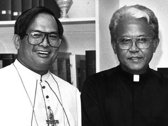 In this Nov. 27, 1987 photo, Monsignor Tomas Camacho, right, is congratulated by Archbishop Anthony Apuron, left, after being named the new bishop for the Commonwealth of the Northern Mariana Islands.