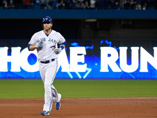 Toronto Blue Jays' Michael Saunders (21) rounds the bases after his solo home run against the Cleveland Indians during second inning, game three American League Championship Series baseball action in Toronto on Monday, Oct. 17, 2016. (Nathan Denette/The Canadian Press via AP)