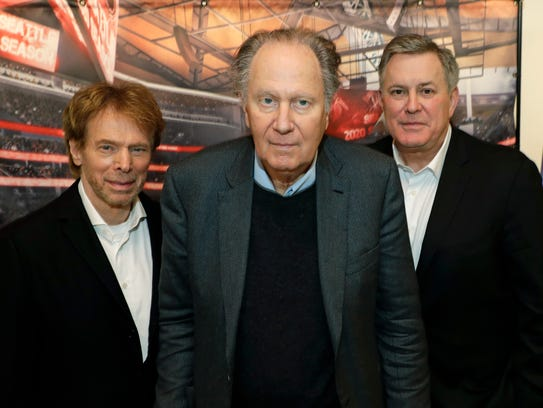 From left, Hollywood producer Jerry Bruckheimer, billionaire