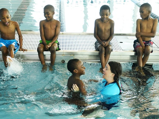 "Heidi Gerkin with Cornelius Johnson at the YMCA's ""Swim"