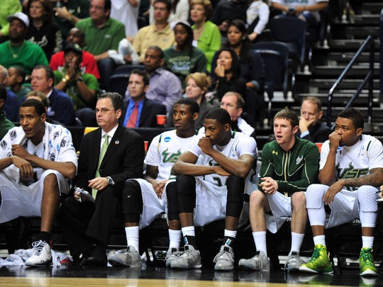 """South Florida team members watch the final moments of a March 18, 2012, game against Ohio in the third round of the 2012 NCAA men's basketball tournament. The Bulls, members of the American Athletic Conference, are a """"doubtful"""" on the Register's Randy Peterson's list of teams that stand a chance at joining the Big 12, should it decide to expand."""