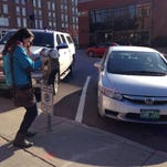 Drivers can pay for a parking spot at kiosks like this one in six lots throughout the city. The parking lots are open on nights and weekends for $2 per hour, according to signs from Unified Parking Partners, a company based in Portland, Maine.