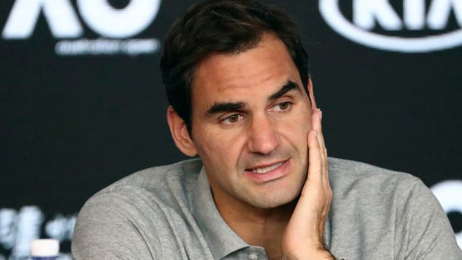 FILE - In this Jan. 30, 2020, file photo, Switzerland's Roger Federer speaks during a press conference following his semifinal loss to Serbia's Novak Djokovic at the Australian Open tennis championship in Melbourne, Australia. Federer leads the annual Forbes ranking of highest-paid athletes with what the magazine says is $106.3 million in total earnings. He is the first tennis player top the list since it was first compiled in 1990.