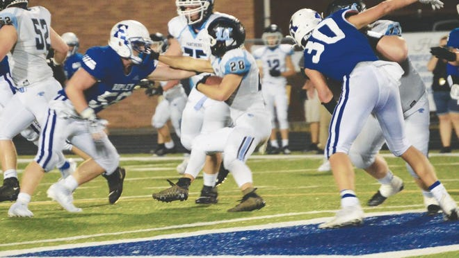 Viking senior Matt Moore, No. 56, goes for the tackle on the ball carrier while Joey Ramsey, No. 30, sets the block.