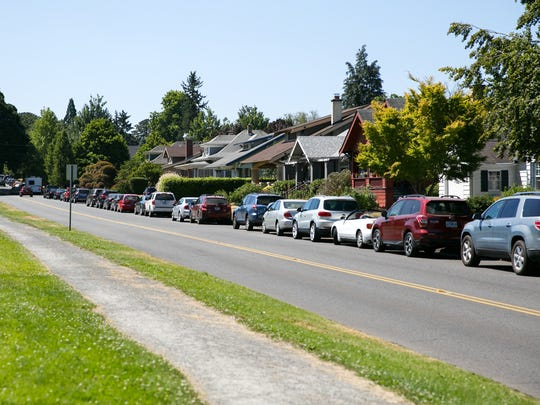 Parking around Bush's Pasture Park begins to fill up for the Salem Art Fair on Friday, July 20, 2018. More than 35,000 people will travel to Salem for the fair, and parking can be scarce.