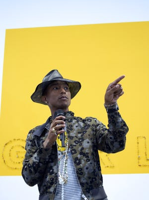 """Pharrell Williams wears a floral print jacket during a press conference for the exibition """"GIRL"""" at the Perrotin Gallery, on May 26. Floral is one of the the summer trends in menswear."""