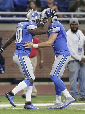 Anquan Boldin, left, and quarterback Matthew Stafford celebrate Boldin's 16-yard TD catch with 19 seconds left in the first half against the Bears on Dec. 11, 2016.