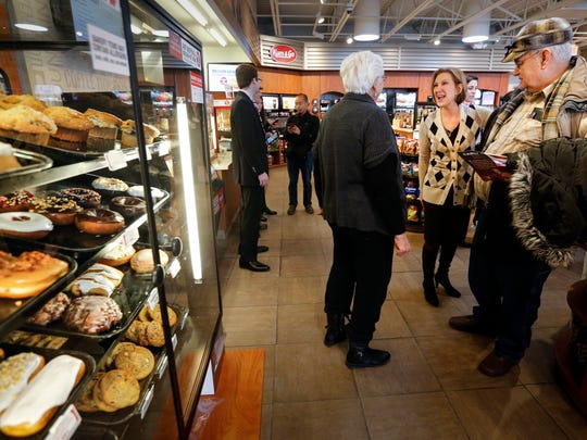 Republican presidential candidate Carly Fiorina chats with Phyllis and Harley Steenhoek, of Mingo, during a campaign stop at  a Kum & Go convenience store in Colfax at 9:13 a.m. Tuesday, Jan. 26, 2016.
