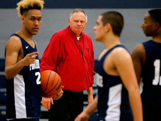 Providence Christian boys basketball coach David Farrar watches Wednesday's practice.