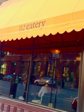You'll find 112 Eatery tucked into a small storefront.  The restaurant aims to provide great food and drinks for diners of all tastes and pocketbooks.