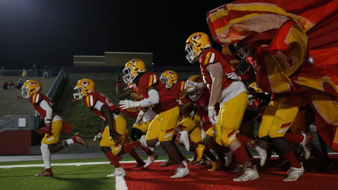 The Clarke Central Gladiators take the field before an GHSA high school football game between Clarke Central and Loganville in Athens, Ga., on Friday Nov. 6, 2020.