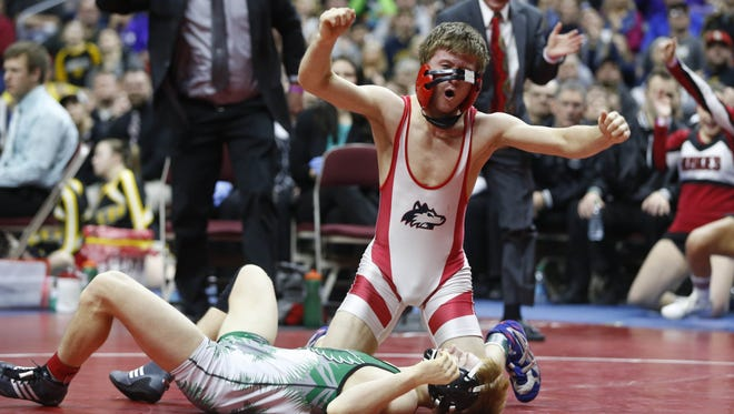 Southeast Highland-Riverside's Bryce West celebrates his win in the 120 pound match over Southeast Warren's Brady Kyner Saturday, Feb. 20, 2016 during the class 1A state wrestling tournament finals in Des Moines.