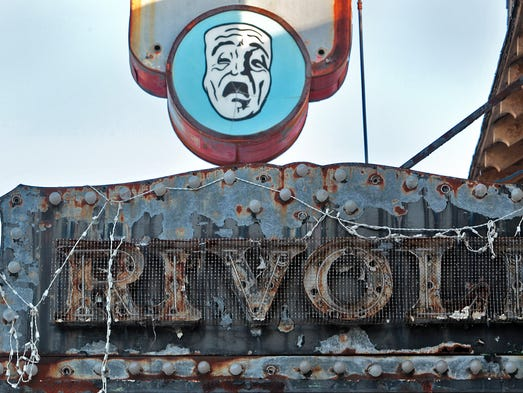 A dilapidated marquis introduces the entrance of the Rivoli Theatre.  The historic movie house, which is in great disrepair, will be renovated as part of the eastside neighborhood restoration.