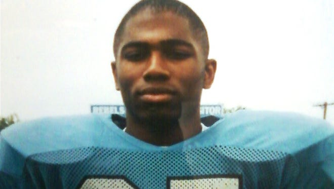 Shaun Alexander wears his blue Boone County football uniform; date of picture unknown.
