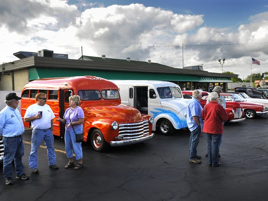 Car owners and enthusiasts gather June 27, 2011, outside