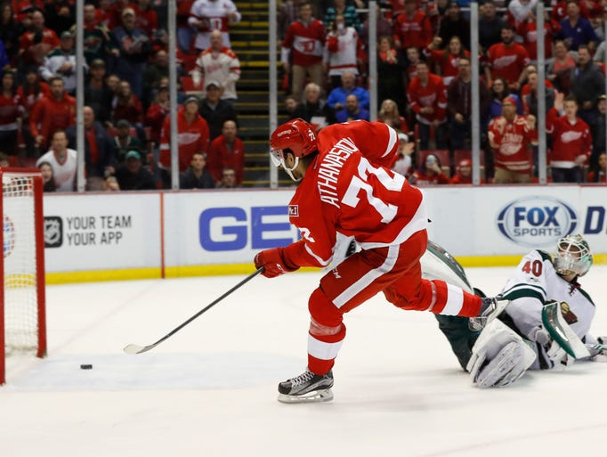 Detroit Red Wings center Andreas Athanasiou (72) scores