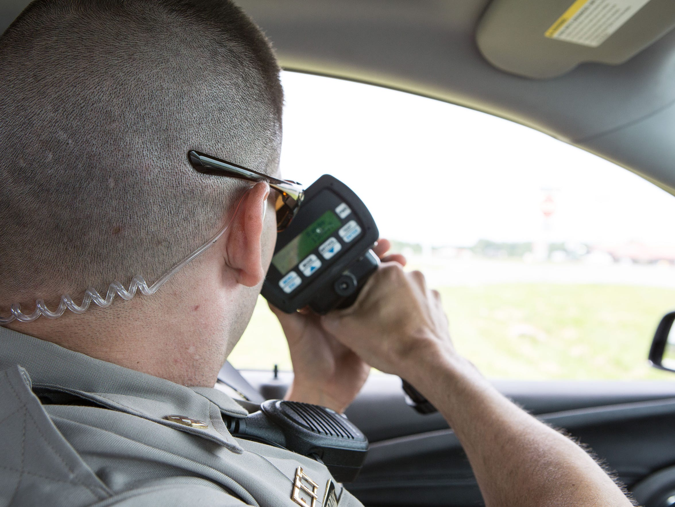TFC Hallman, scans the highway for speeding motorists