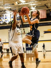Hartland's Michelle Moraitis goes up for a shot while