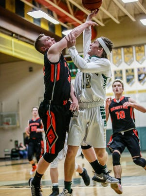 Brighton junior Dalton Porth (left) scored 14 points in the Bulldogs' district semifinal loss Wednesday night against South Lyon.
