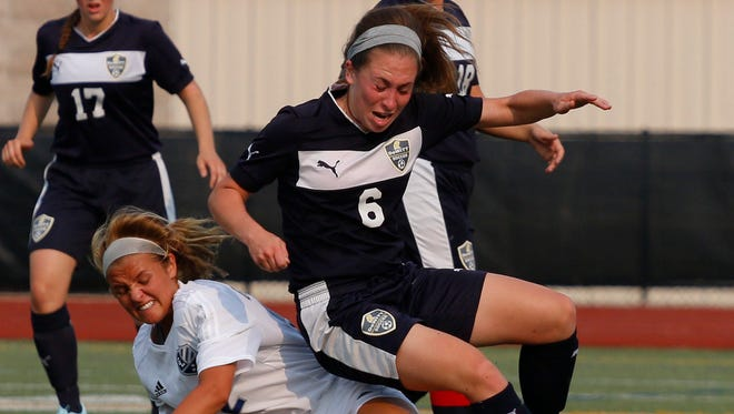 DeWitt's Madelyn Dickens, right, and Richland Gull Lake's Braeden Snow battle for the ball during their state semifinal game Tuesday, June 9, 2015, at Grand Rapids Christian High School in Grand Rapids, Mich. DeWitt fell 1-0.