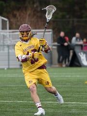 Salisbury University's Corey Gwin (18) passes the ball
