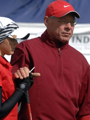Richmond coach Joe Moehring with player Ashytn Brown at The Legends of Indiana in Franklin prior to the first tee shot by the Red Devil golfer in the IHSAA State Golf Tournament Friday afternoon October 2, 2009.