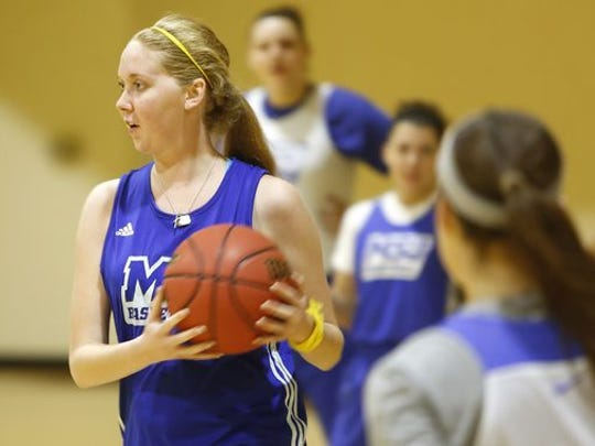 Mt. St. Joseph College sophomore basketball player Lauren Hill practices a play especially designed for Hill to make a lay-up in the Nov. 2 game.