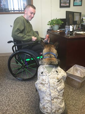 Throughout his rehab, Nick Taylor has enjoyed the company of Staff Sergeant Archie, a Marine Corps Service Dog.
