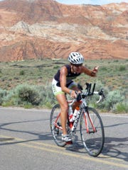 Elizabeth Dansie competes in the 2015 St. George Ironman 70.3 mile triathlon Saturday, May 2, 2015. Dance was the first local female athlete to finish the 2015 St. George Ironman. Major events like the Ironman have contributed to an increase in the number of cycling amenities offered throughout the southwest Utah area.