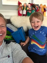 Chris Wragge and his son Christian at play, making