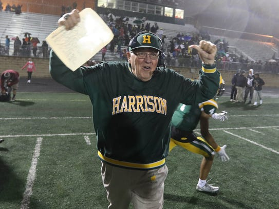 Farmington Hills Harrison coach John Herrington celebrates