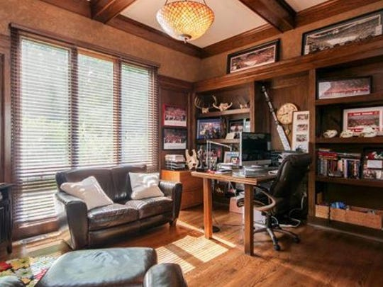 This is the listing's photo of Mike Babcock's study, which contains some of his hockey memories.