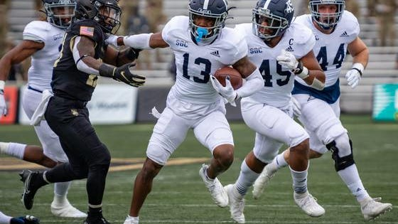 Georgia Southern cornerback Derrick Canteen (13) recovers a fumble and returns it 22 yards for a first-quarter touchdown against Army on Saturday at Michie Stadium in West Point, N.Y.