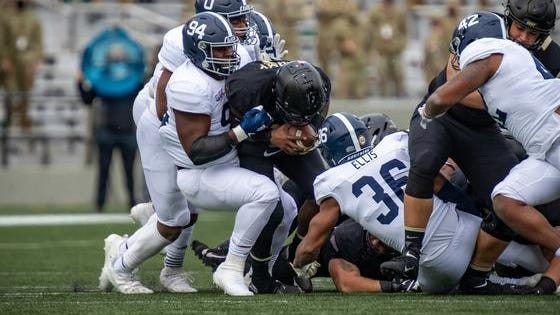 Georgia Southern junior nose tackle C.J. Wright (94) makes a tackle against Army on Saturday at Michie Stadium in West Point, N.Y.