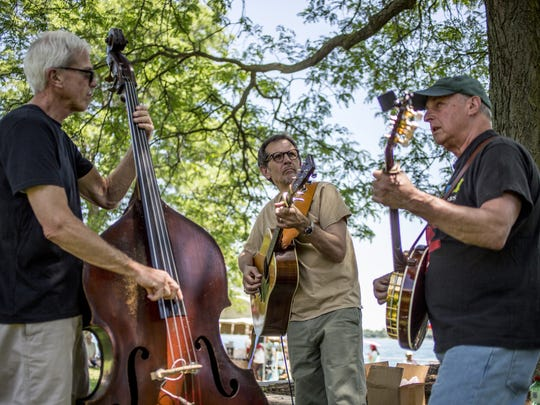 John Denomme, Jerry Castle and Dennis Cyporyn perform as the Dennis Cyporyn Band in Palmer Park during the St. Clair Art Fair.