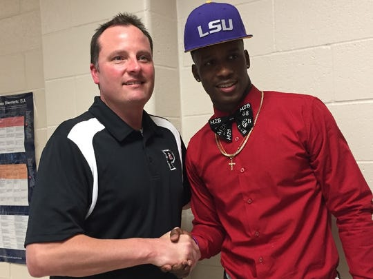 LSU signee Terrace Marshall shakes hands with Parkway principal Waylon Bates.
