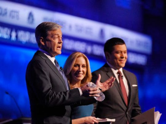 Debate moderators John Harwood, left, Becky Quick, center, and Carl Quintanilla take the stage during the CNBC Republican presidential debate at the University of Colorado Oct. 28, 2015, in Boulder, Colo.