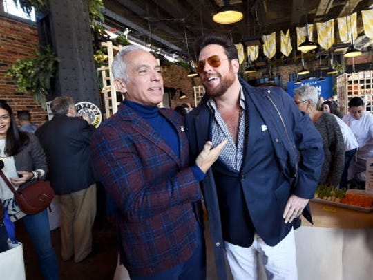 Chefs Geoffrey Zakarian, left, and Scott Conant attend Greenmarket Brunch in New York City in October. Zakarian is one of the chefs being sued in an ongoing litigation involving Donald Trump and his luxury hotel in Washington.