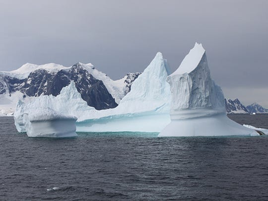 An Iceberg photographed from the Laurence M. Gould research cruise vessel near Avian Island, Antarctica.