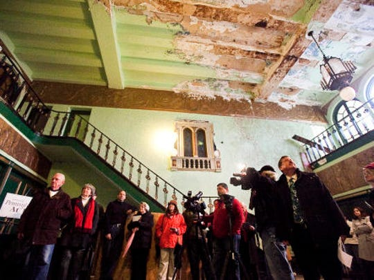 People attend a press conference at the downtown Hanover Theater in 2012. 'This is not a building beyond saving. This building has been maintained,' a Preservation Pennsylvania spokesman said.